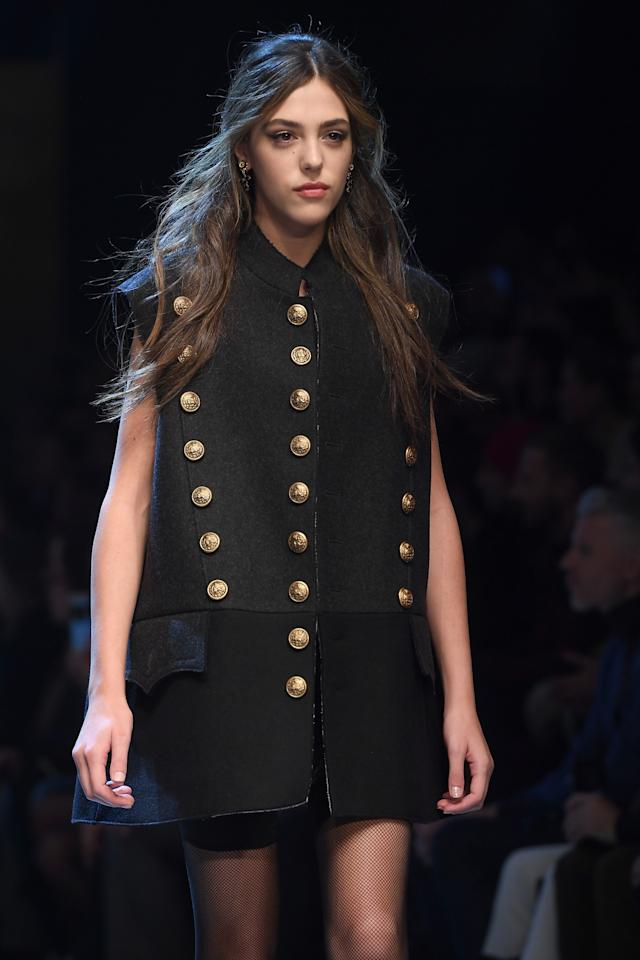 Sistine Stallonegraduated from sitting front row at the Dolce & Gabbana's spring 2017 show in Milan last September to walking down the brand's runway last weekend. The 17-year-old model wore anoversized coat and a lacy black slip dress underneath.(Photo: Getty)