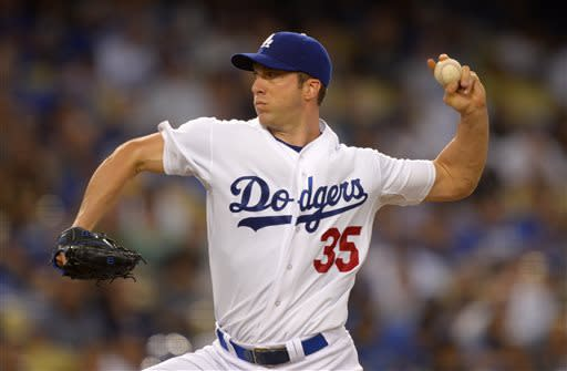 Los Angeles Dodgers starting pitcher Chris Capuano throws to the plate during the third inning of the Dodgers' baseball game against the Colorado Rockies, Thursday, July 11, 2013 in Los Angeles. (AP Photo/Mark J. Terrill)