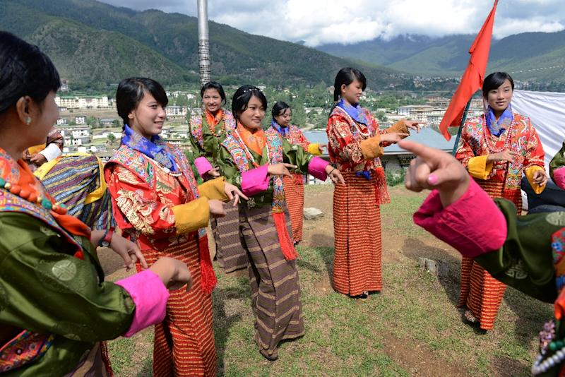 Bhutanese schoolgirls practice a dance. Teachers in the Himalayan kingdom will see a pay rise of 100 percent and allowances (AFP Photo/ROBERTO SCHMIDT)