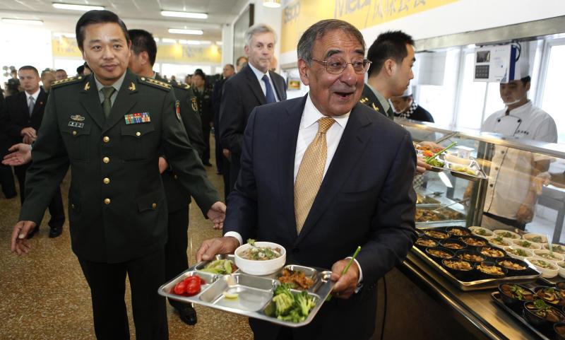 U.S. Defense Secretary Leon Panetta carries his lunch with cadets in the mess hall at the PLA Engineering Academy of Armored Forces in Beijing, Wednesday, Sept. 19, 2012. U.S. Defense Secretary Panetta is telling Chinese troops that America's new military focus on the Asia Pacific, including plans to put a second radar system in Japan, is not an attempt to contain or threaten China. (AP Photo/Larry Downing, Pool)