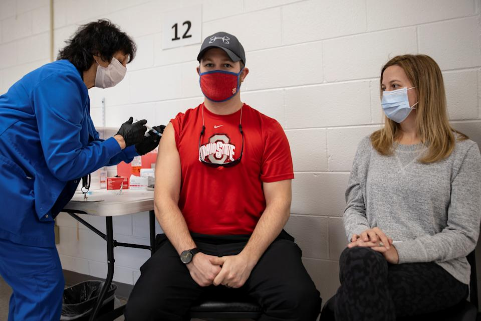 Jake Lawler, 29, receives his coronavirus disease (COVID-19) vaccine as vaccine eligibility expands to anyone over the age of 16 at the Bradfield Community Center through Health Partners of Western Ohio in Lima, Ohio, U.S., March 29, 2021.  REUTERS/Megan Jelinger     TPX IMAGES OF THE DAY