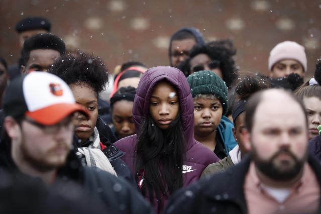 Students gather on a soccer field during a 17-minute walkout protest at the Stivers School for the Arts in Dayton, Ohio, on Wednesday. (John Minchillo/AP)