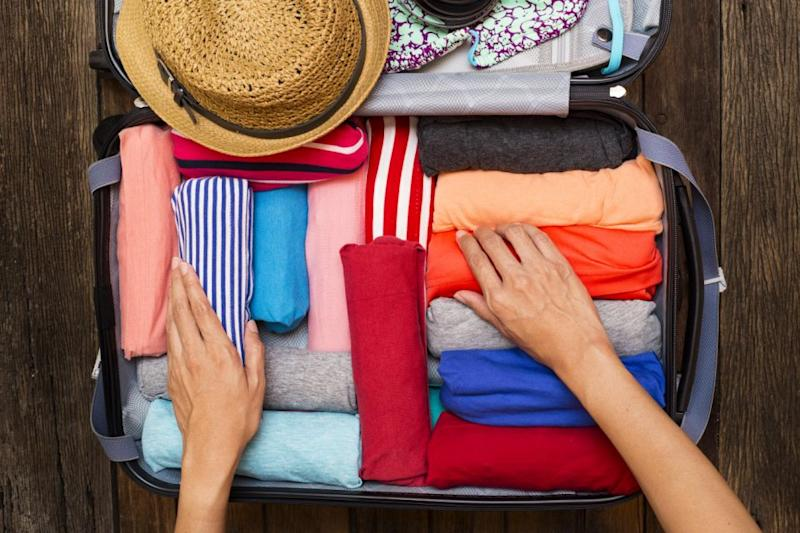 Chris rolls and folds his clothes to maximise space. Photo: Getty