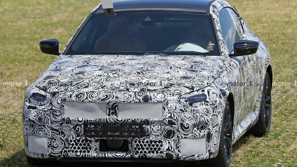 """<p>The upcoming BMW 2 Series Coupe is deep into development. The engineers aren't stripping off too much camo yet.</p> <h3><a href=""""https://www.motor1.com/news/433722/bmw-2-series-coupe-spy-photos/"""" rel=""""nofollow noopener"""" target=""""_blank"""" data-ylk=""""slk:Next-Gen BMW 2 Series Coupe Spotted Again In Multiple Flavors"""" class=""""link rapid-noclick-resp"""">Next-Gen BMW 2 Series Coupe Spotted Again In Multiple Flavors</a></h3> <br><a href=""""https://www.motor1.com/news/432271/bmw-2-series-coupe-spy-images/"""" rel=""""nofollow noopener"""" target=""""_blank"""" data-ylk=""""slk:BMW 2 Series Coupe Spied For The First Time In Mexico"""" class=""""link rapid-noclick-resp"""">BMW 2 Series Coupe Spied For The First Time In Mexico</a><br><a href=""""https://www.motor1.com/news/418733/bmw-2-series-coupe-rendering/"""" rel=""""nofollow noopener"""" target=""""_blank"""" data-ylk=""""slk:2022 BMW 2 Series Coupe Already Rendered Based On The Spy Shots"""" class=""""link rapid-noclick-resp"""">2022 BMW 2 Series Coupe Already Rendered Based On The Spy Shots</a><br>"""