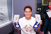 FILE- In this Sept. 28, 1988, file photo, two-time double gold medalist Greg Louganis shows off the two medals he won at the 1988 Summer Olympic Games in Seoul as he arrives in Los Angeles, Calif. As an athlete mentor at the London Olympics, Louganis is trying to make sure the stress of winning medals isn't heaped on the shoulders of American divers, who have been chasing his standard of excellence since he became the sport's icon in the 1980s. The U.S. has been blanked in diving in two consecutive Olympics, and hasn't won a gold since 2000. (AP Photo/Bob Galbraith, File)
