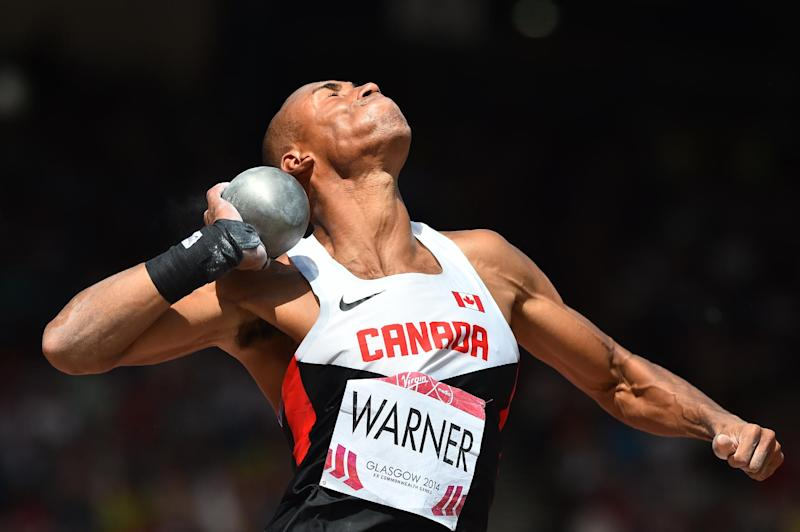 Canada's Damian Warner competes in the men's decathlon shot put athletics event at Hampden Park during the 2014 Commonwealth Games in Glasgow, Scotland on July 28, 2014 (AFP Photo/Ben Stansall)