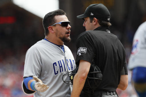 Chicago Cubs' Kyle Schwarber, left, has words with umpire John Tumpane after being thrown out of a baseball game for arguing balls and strikes in the seventh inning against the Cincinnati Reds, Sunday, May 20, 2018, in Cincinnati. (AP Photo/John Minchillo)