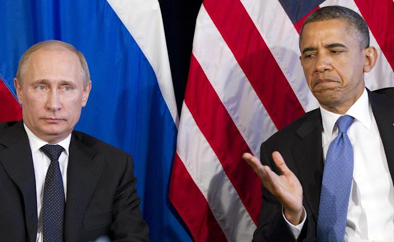 FILE- In this June 18, 2012 file photo President Barack Obama participates in a bilateral meeting with Russia's President Vladimir Putin during the G20 Summit in Los Cabos, Mexico. Nearly five years into Obama's presidency, the perception of a president lacking in international influence extends beyond the Arab world, particularly to Russia; an ambitious attempt to reset U.S. relations with Russia faltered and failed. Putin, who reassumed the presidency in 2012, has blocked U.S. efforts to seek action against Syria at the United Nations and has balked at Obama's efforts to seek new agreements on arms control. (AP Photo/Carolyn Kaster, file)