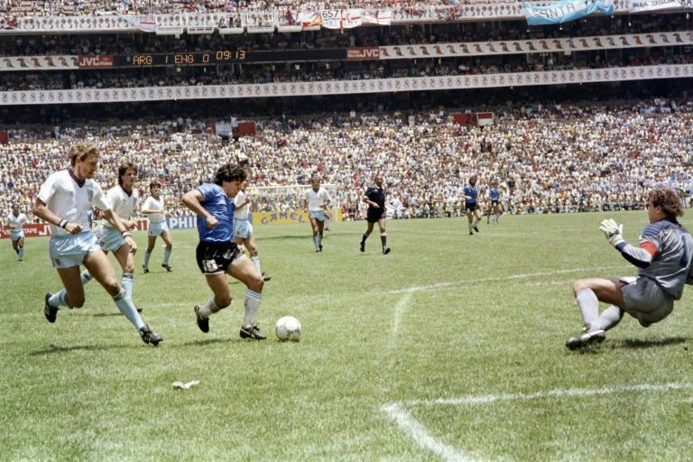 Diego Maradona runs past England defender Terry Butcher on his way to dribbling goalkeeper Peter Shilton and scoring his second goal in Argentina's 2-1 win in the 1986 World Cup quarter-final. It was later named the goal of the century