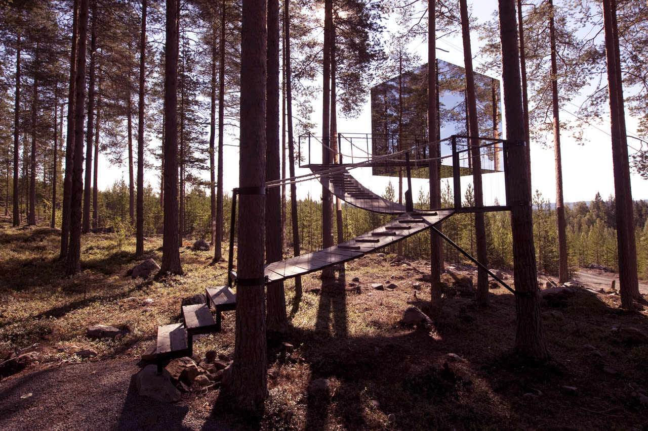 """<p>They call it the invisible treehouse: <a href=""""http://treehotel.se/mirrorcube"""">Treehotel's Mirrorcube</a> in Harrads, Sweden has a mirrored exterior that mimics the surrounding forest with its reflective glass, creating an almost-entirely camouflaged cube suspended in the woods. Inside, six windows look out to jaw-dropping panoramic views within the 4 x 4 x 4-meter aluminum-and-birch-framed structure, which can be rented by the night and comes with a double bed, bath, lounge, kitchenette, and even a rooftop terrace. From $478. (Photo: Peter Lundstrom)</p>"""