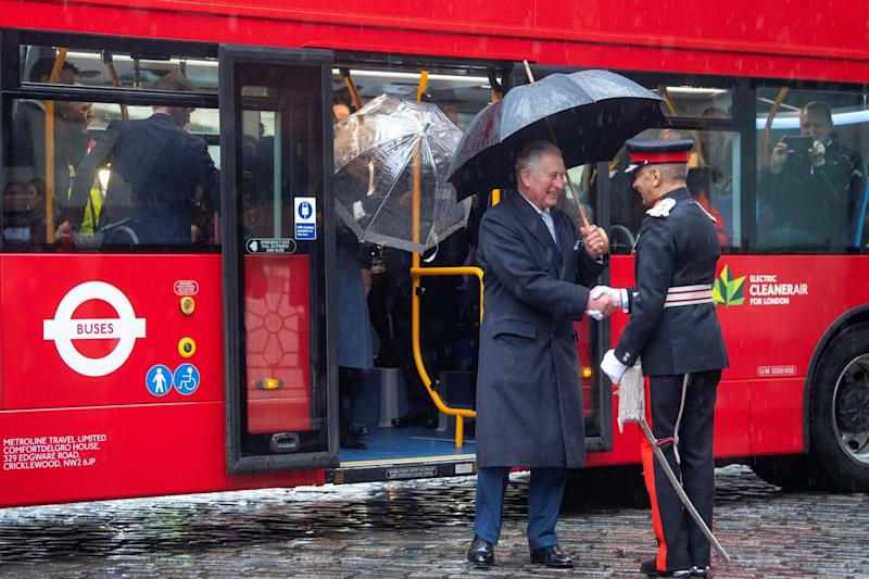 Prince Charles steps off a new electric double decker bus (REUTERS)