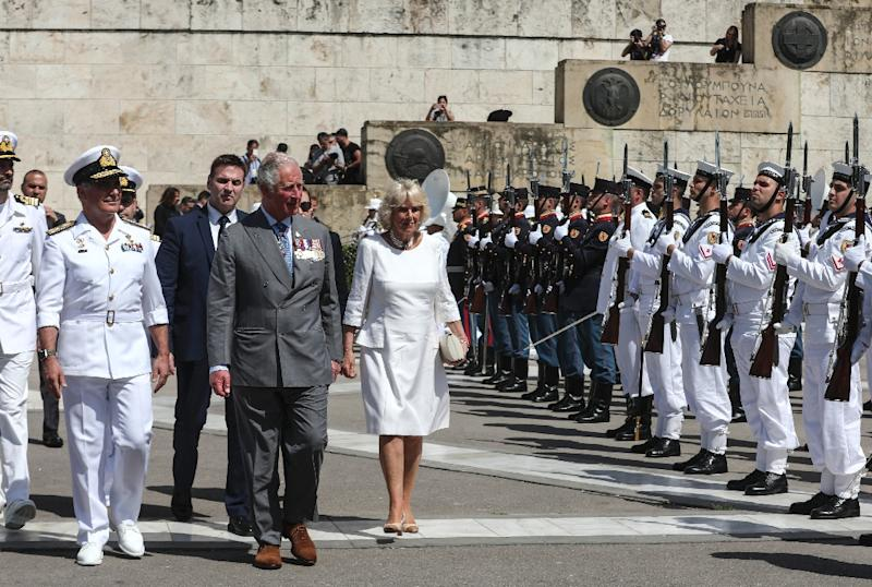 Prince Charles and his wife Camilla visited the Tomb of the Unknown Soldier in Athens during a three-day official visit. (AFP Photo/-)