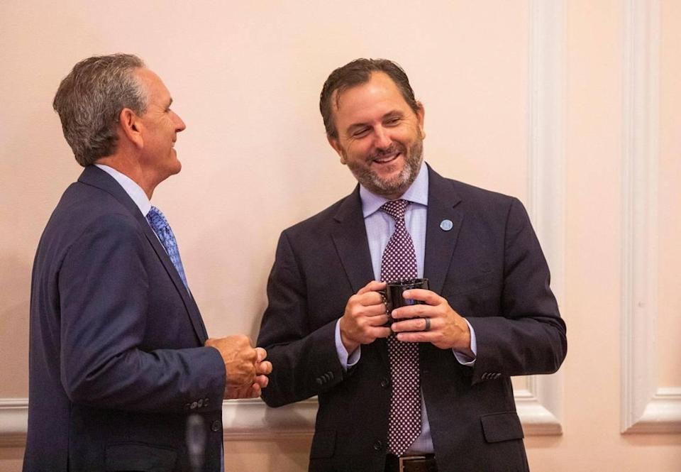 Rob Bryan, right, socializes before the start of his first meeting as a member of the UNC Board of Trustees, at the Carolina Inn, on Thursday, July 15, 2021, in Chapel Hill, N.C.