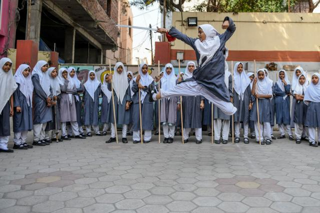 A girl practices 'Vovinam', a Vietnamese martial art at a school in Hyderabad (Photo by NOAH SEELAM/AFP via Getty Images)