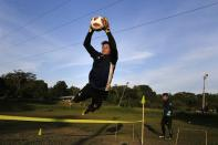 Goalkeeper Jorge Chena of the second division Atyra F.C., who hasn't been paid by his club for more than a year, trains in Nemby, Paraguay, Monday, Feb. 8, 2021. Chena has started working as a carpenter at age 32 despite his 13 year-long soccer career, to survive during the COVID-19 pandemic. (AP Photo/Jorge Saenz)