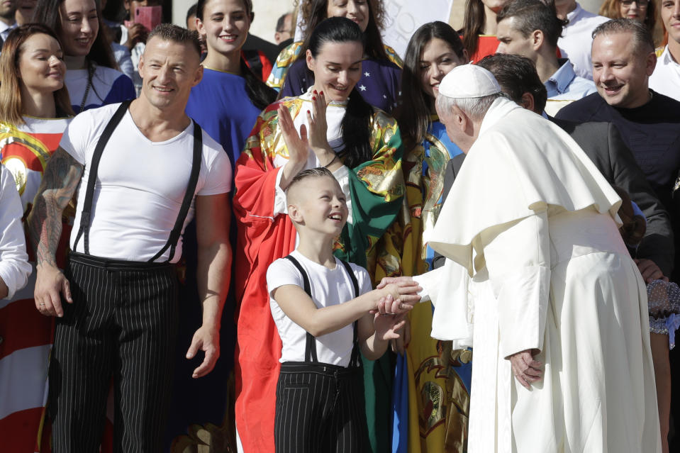 Pope Francis greets participants at the Italian International Circus festival, during his weekly general audience, in St.Peter's Square, at the Vatican, Wednesday, Oct. 16, 2019. (AP Photo/Andrew Medichini)