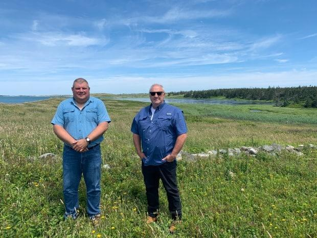 Roy White and Bernie Berry say they worry the proposed salmon farm could damage wetland along the coast of southwest Nova Scotia. They want local leaders to reject the project.  (Phlis McGregor/CBC - image credit)
