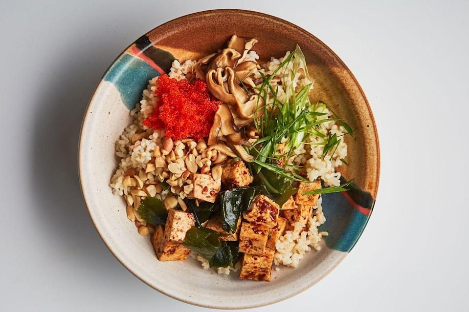 """Tofu gets bold flavor from this spicy, salty, and deeply seasoned marinade. If you've never pickled mushrooms before, you're in for a treat. It's one of our favorite ways to prepare shiitakes. <a href=""""https://www.epicurious.com/recipes/food/views/spicy-tofu-with-pickled-shiitake-mushrooms?mbid=synd_yahoo_rss"""" rel=""""nofollow noopener"""" target=""""_blank"""" data-ylk=""""slk:See recipe."""" class=""""link rapid-noclick-resp"""">See recipe.</a>"""
