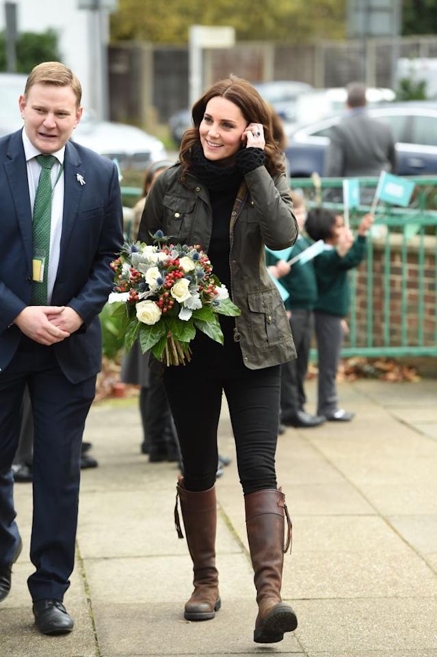 """<p>Kate Middleton was all smiles as she <a rel=""""nofollow"""" href=""""https://ca.style.yahoo.com/kate-middletons-top-pregnancy-style-slideshow-wp-155058412.html"""">visited Robin Hood Primary School on Wednesday, Nov. 28 2017, </a>to celebrate 10 years of The Royal Horticultural Society's campaign for school gardening. The Duchess, pregnant with her third child, coyly concealed her baby bump underneath a green waxed jacket and marked the event in fitted black jeans and her favourite pair of knee-high leather boots. <em>(Photo: Getty)</em> </p>"""