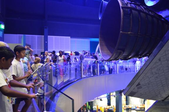 Crowds come face to face with the space shuttle Atlantis June 29, 2013, on opening day of its exhibition at the Kennedy Space Center Visitor Complex in Cape Canaveral, Florida.