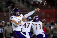 East Carolina quarterback Holton Ahlers throws a pass during the first half of the team's NCAA college football game against Cincinnati, Friday, Nov. 13, 2020, in Cincinnati. (AP Photo/Aaron Doster)