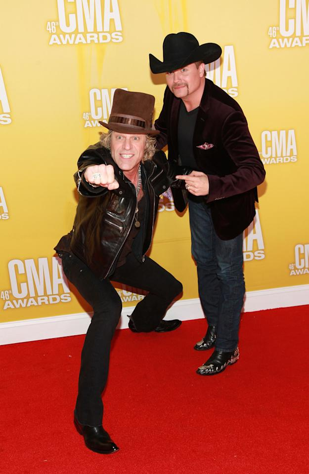 "<p class=""MsoNormal"">As usual, Big & Rich hammed it up for the photographers on the red carpet. While Big Kenny (left) sported his infamous top hat and a leather jacket, John Rich made a statement in a velvet blazer and pair of snazzy boots. (11/1/2012)</p>"