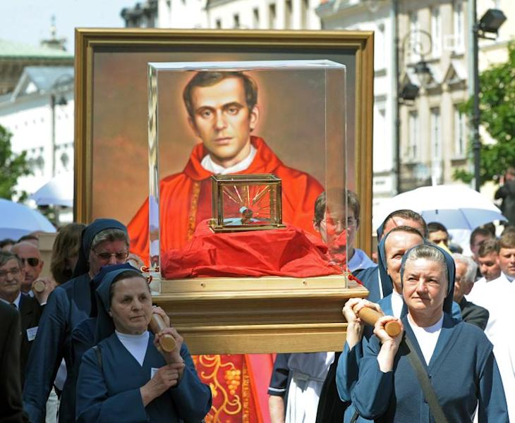Nuns carry relics of Jerzy Popieluszko in Warsaw at a procession after his beatification mass in 2010. The dissident priest was a key figure in Poland's anti-communist movement and was abducted, tortured and murdered by secret police 30 years ago
