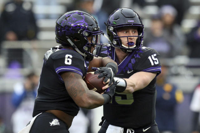 TCU running back Darius Anderson (6) takes the hand off from quarterback Max Duggan (15) in the first quarter of an NCAA college football game Friday, Nov. 29, 2019, in Fort Worth, Texas. (AP Photo/Richard W. Rodriguez)