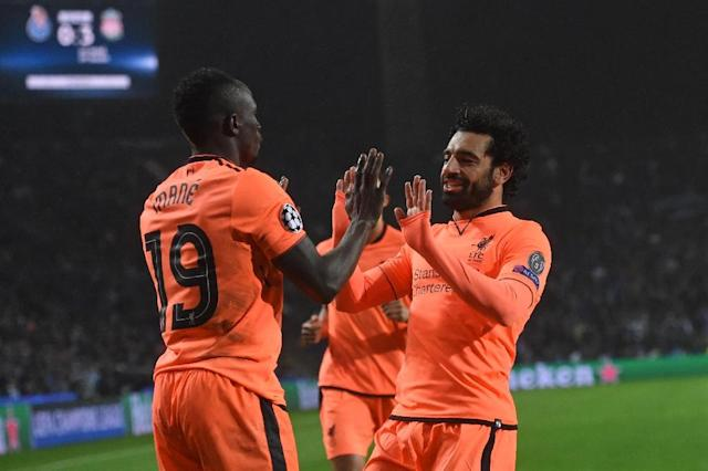 Liverpool's Sadio Mane (L) celebrates with teammate Mohamed Salah after scoring a goal during their UEFA Champions League round of 16 first leg match against Porto, at the Dragao stadium in Porto, Portugal, on February 14, 2018 (AFP Photo/Francisco LEONG)