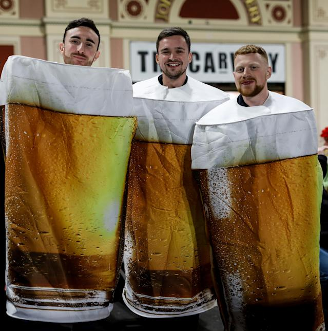 Not content with drinking pints, these fans turned up dressed as them. (Photo by Steven Paston/PA Images via Getty Images)