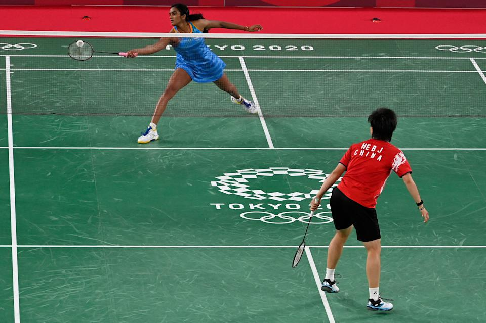 India's P. V. Sindhu (top) hits a shot to China's He Bingjiao in their women's singles badminton bronze medal match during the Tokyo 2020 Olympic Games at the Musashino Forest Sports Plaza in Tokyo on August 1, 2021. (Photo by Alexander NEMENOV / AFP) (Photo by ALEXANDER NEMENOV/AFP via Getty Images)