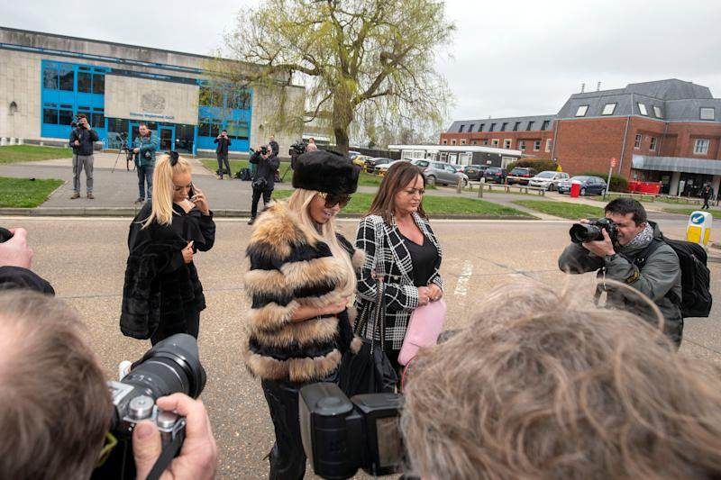Katie Price (centre) leaves Crawley Magistrates' Court where she appeared on two counts of using threatening, abusive, words or behaviour to cause harassment, alarm or distress.
