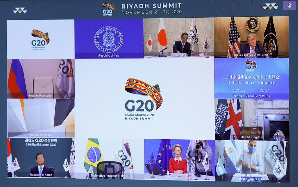 Japanese Prime Minister Yoshihide Suga (top L), US President Donald Trump (top R), South Korean President Moon Jae-in (down L), and European Commission President Ursula von der Leyen (down C) are seen on a screen before the start of a virtual G20 summit hosted by Saudi Arabia and held over video conference amid the Covid-19 (novel coronavirus) pandemic, in Brussels, on November 21, 2020. - Saudi Arabia hosts a G20 summit on November 21 and 22, in a first for an Arab nation, with the virtual forum dominated by efforts to tackle the coronavirus pandemic and the worst global recession in decades. (Photo by YVES HERMAN / POOL / AFP) (Photo by YVES HERMAN/POOL/AFP via Getty Images)