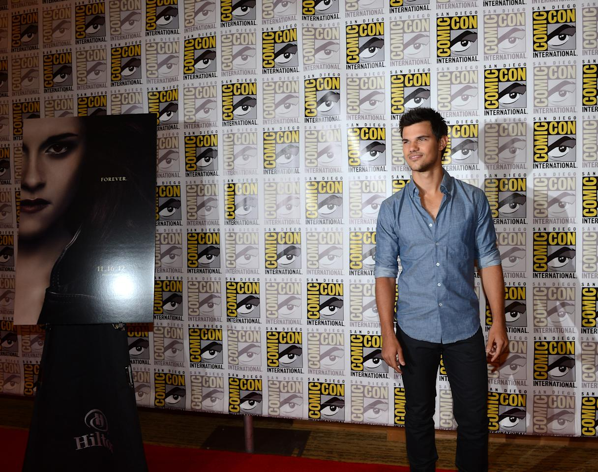 """SAN DIEGO, CA - JULY 12:  Actor Taylor Lautner arrive at the press conference for """"The Twilight Saga: Breaking Dawn - Part 2"""" at San Diego Comic-Con 2012 at San Diego Convention Center on July 12, 2012 in San Diego, California.  (Photo by Michael Buckner/Getty Images for Lionsgate)"""