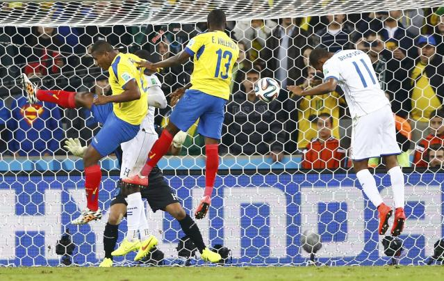 Ecuador's Enner Valencia (13) heads to score a goal during the 2014 World Cup Group E soccer match between Honduras and Ecuador at the Baixada arena in Curitiba June 20, 2014. REUTERS/Darren Staples (BRAZIL - Tags: TPX IMAGES OF THE DAY SOCCER SPORT WORLD CUP)