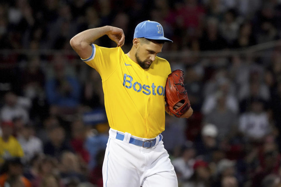 Boston Red Sox starting pitcher Nathan Eovaldi (17) pulls on his jersey between pitches during the third inning of a baseball game against the New York Yankees at Fenway Park, Friday, Sept. 24, 2021, in Boston. (AP Photo/Mary Schwalm)
