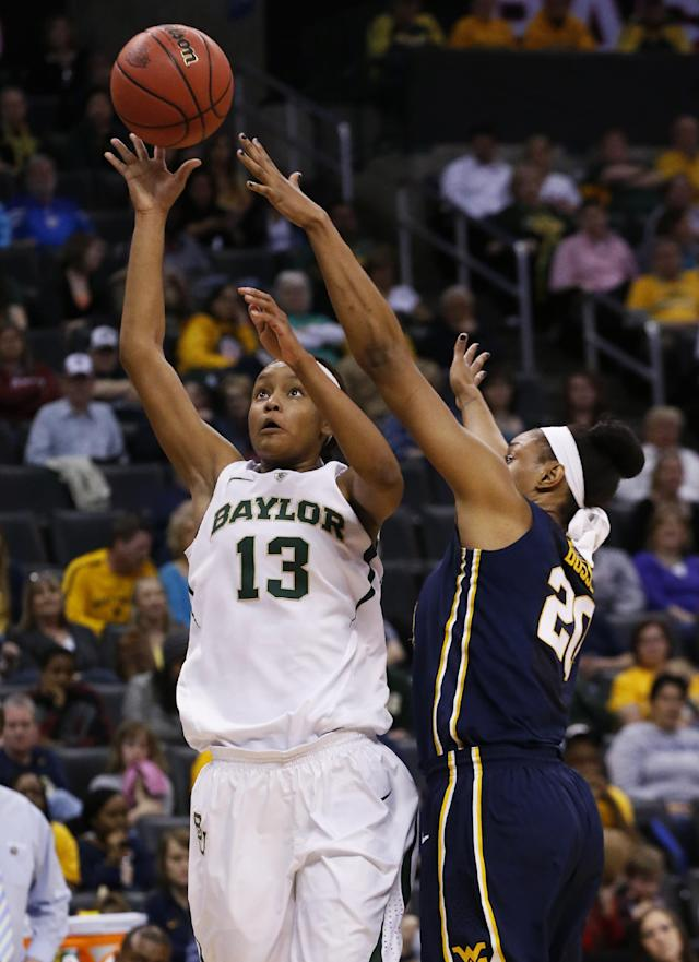 Baylor forward Nina Davis (13) shoots in front of West Virginia center Asya Bussie (20) in the first half of an NCAA college basketball game in the finals of the Big 12 Conference women's college tournament in Oklahoma City, Monday, March 10, 2014. (AP Photo/Sue Ogrocki)