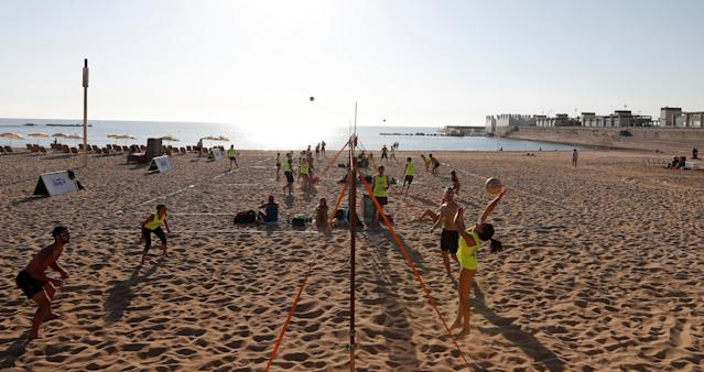 People play beach volleyball on a hot day in Barceloneta beach in Barcelona, Spain, October 15, 2017. REUTERS/Gonzalo Fuentes