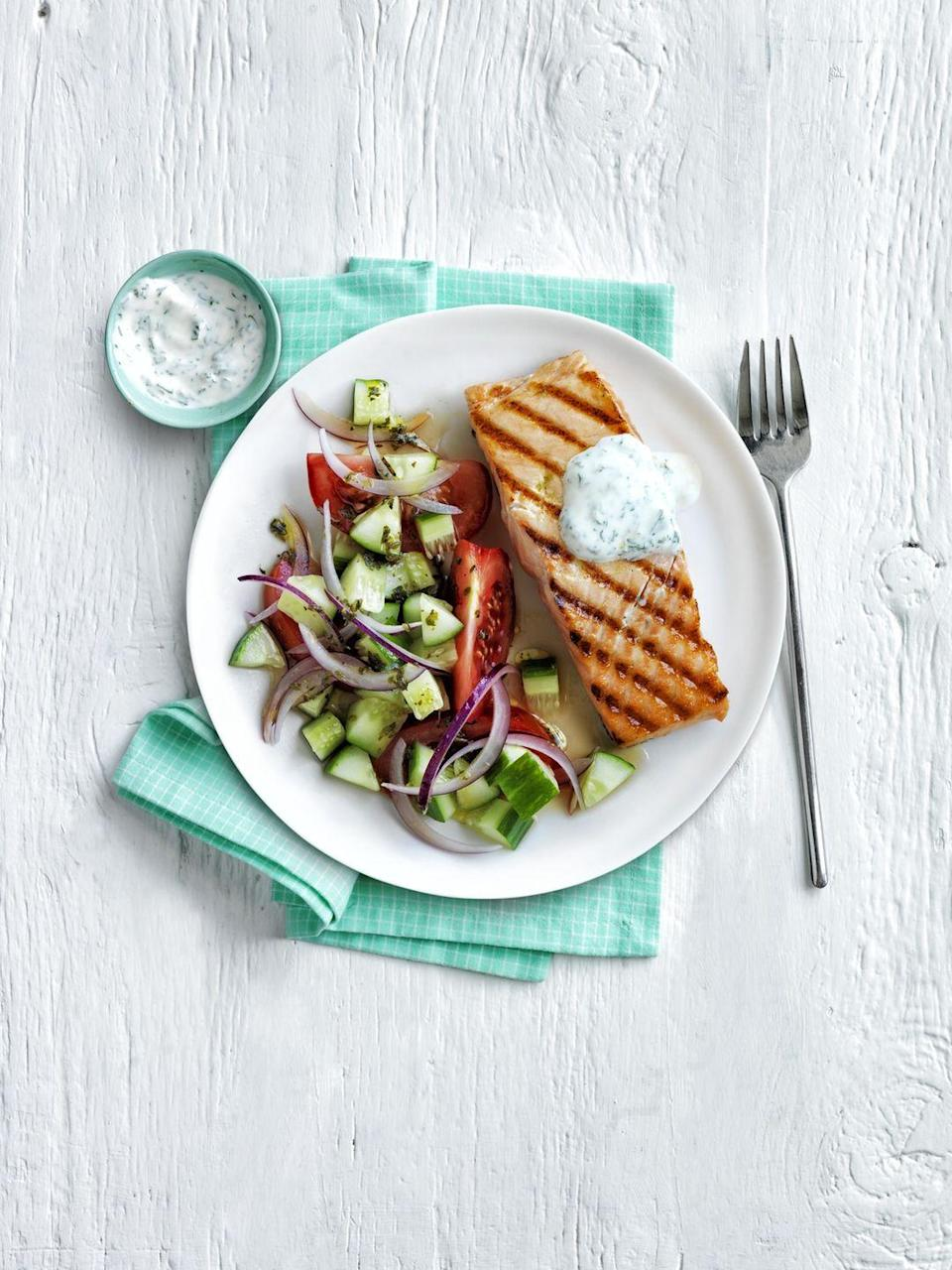 """<p>Grilled salmon pairs perfectly with an herby salad and lemony tzatziki.</p><p><em><a href=""""https://www.womansday.com/food-recipes/food-drinks/recipes/a54835/grilled-salmon-with-greek-salad-recipe/"""" rel=""""nofollow noopener"""" target=""""_blank"""" data-ylk=""""slk:Get the Grilled Salmon with Greek Salad recipe."""" class=""""link rapid-noclick-resp"""">Get the Grilled Salmon with Greek Salad recipe.</a></em></p>"""