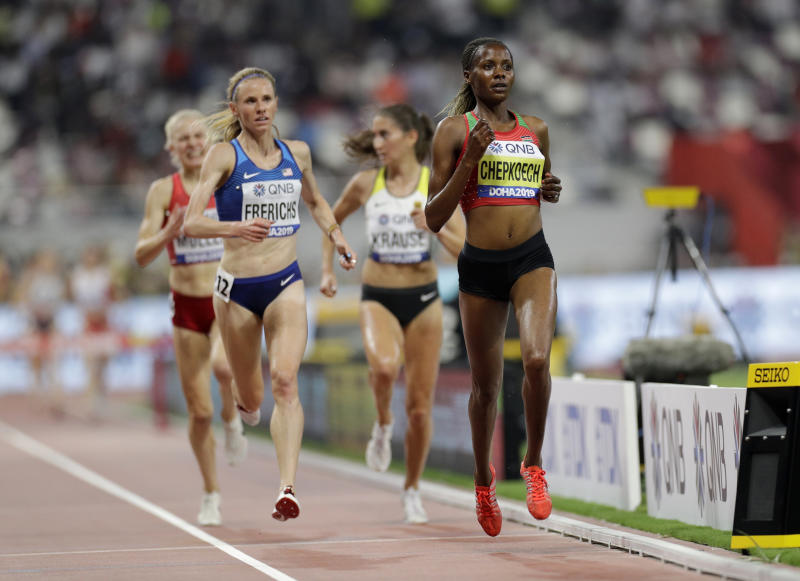 Kenya's Beatrice Chepkoech, right, and Courtney Frerichs of the United States compete during the women's 3,000 meters steeplechase heats at the World Athletics Championships in Doha, Qatar, Friday, Sept. 27, 2019. (AP Photo/Petr David Josek)