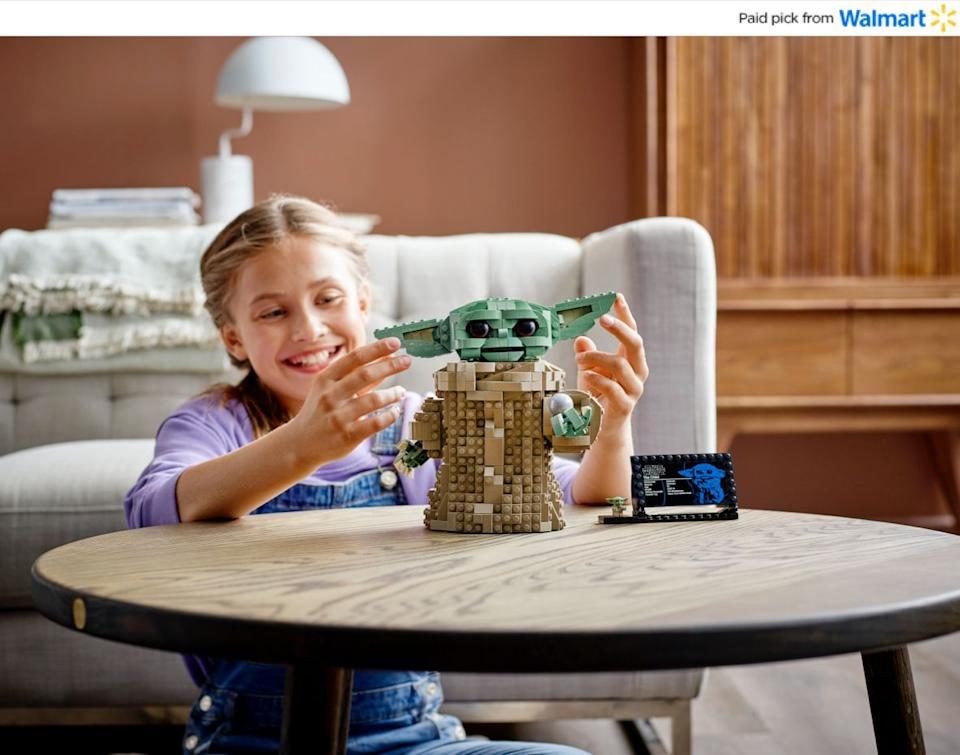 """If they can't sit still, this LEGO set will keep them busy for a bit. It features all the pieces for them to build their very own Baby Yoda with """"a posable head, movable ears and an adjustable mouth.""""And when all's said and done, they can say they made it themselves.<a href=""""https://www.walmart.com/ip/LEGO-Star-Wars-The-Mandalorian-The-Child-75318-Collectible-Buildable-Toy-Model-for-Ages-10-1-073-Pieces/655256952?sourceid=aff_ov_338446cb-ecfc-4727-be8a-820e84f07845&veh=aff&wmlspartner=aff_ov_338446cb-ecfc-4727-be8a-820e84f07845&cn=FY21-Holiday-Gifting_st_hw_aff_nap_ov_snl_oth"""" target=""""_blank"""" rel=""""noopener noreferrer"""">Find it for $80 at Walmart</a>."""