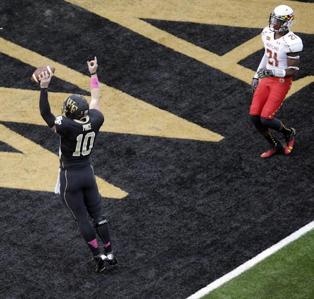 Wake Forest's Tanner Price (10) celebrates after catching a touchdown pass as Maryland's Sean Davis (21) watches during the first half of an NCAA college football game in Winston-Salem, N.C., Saturday, Oct. 19, 2013. (AP Photo/Chuck Burton)