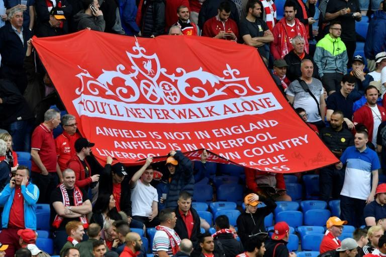 "Liverpool's supporters hold a banner reading ""You'll Never Walk Alone"", a reference to Gerry Marsden's version of the song"