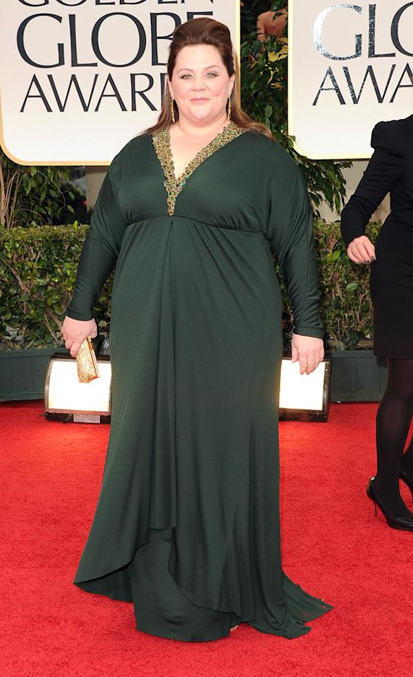 "<b>Melissa McCarthy</b> <br><b>Grade: B</b> <br><br>Melissa McCarthy got glitzier than usual in a long-sleeve, dark green Badgley Mischka gown with a bejeweled neckline and drop earrings. The ""Bridesmaids"" scene stealer also gave her tresses a boost with a pony mane."