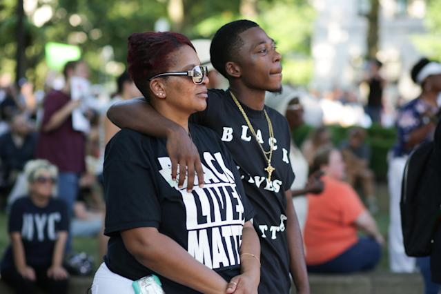 Kimberly Allen, 44, of Oak Hill, West Virginia, embraces her son, Michael Hodge, 19, of Oak Hill, West Virginia, during a Black Lives Matter rally in Charleston, West Virginia, U.S., August 20, 2017. REUTERS/Marcus Constantino