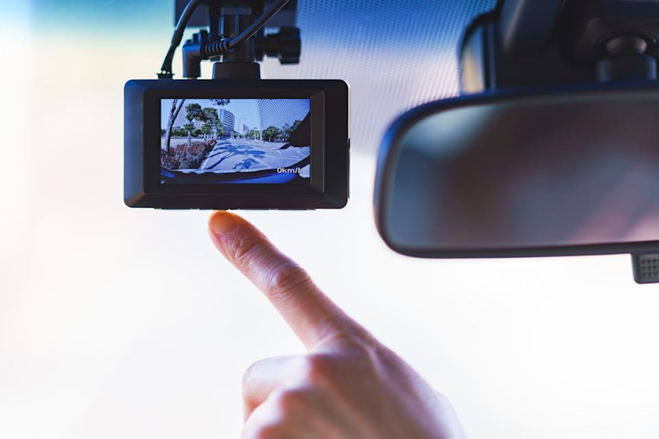 Driver pointing to dashcam. Source: Getty Images