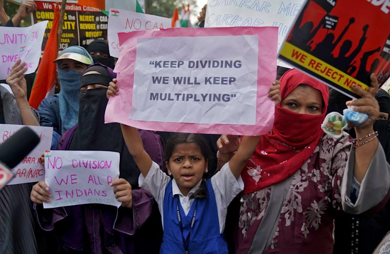 Demonstrators holding placards shout slogans as they attend a protest rally against a new citizenship law, in Hyderabad