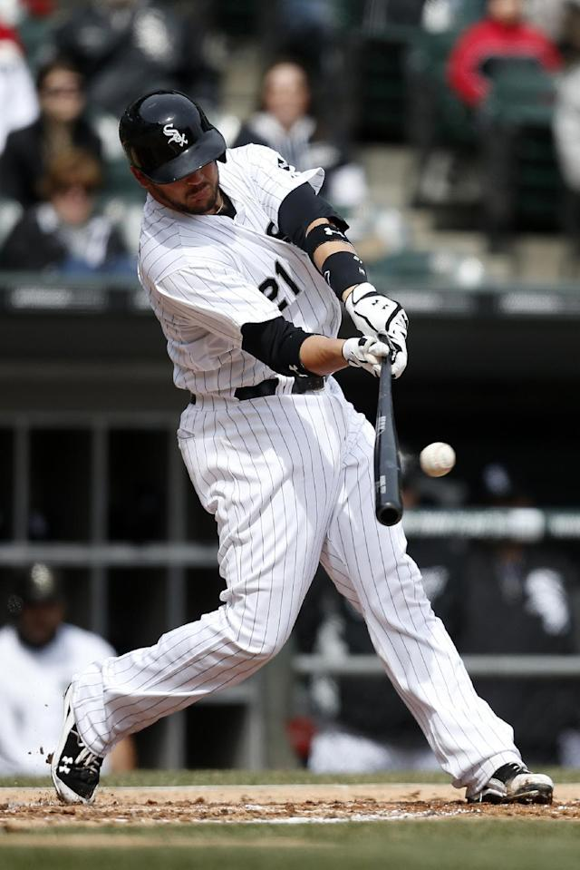 Chicago White Sox catcher Tyler Flowers hits a single against the Minnesota Twins during the second inning of a baseball game on Wednesday, April 2, 2014, in Chicago, Ill. (AP Photo/Andrew A. Nelles)