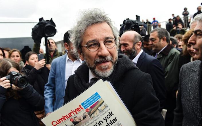 """""""We are here to defend journalism,"""" said Turkish daily Cumhuriyet's editor-in-chief Can Dundar outside the court in Istanbul (AFP Photo/Bulent Kilic)"""
