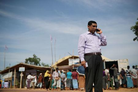 Mohib Ullah, a leader of Arakan Rohingya Society for Peace and Human Rights, talks on the phone in Kutupalong camp in Cox's Bazar